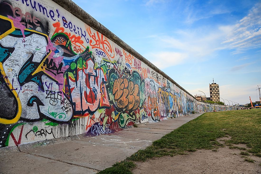Today, segments of the Berlin Wall remain to serve as a reminder of the city's history. Photo  credit: Noppasin / Shutterstock.com.