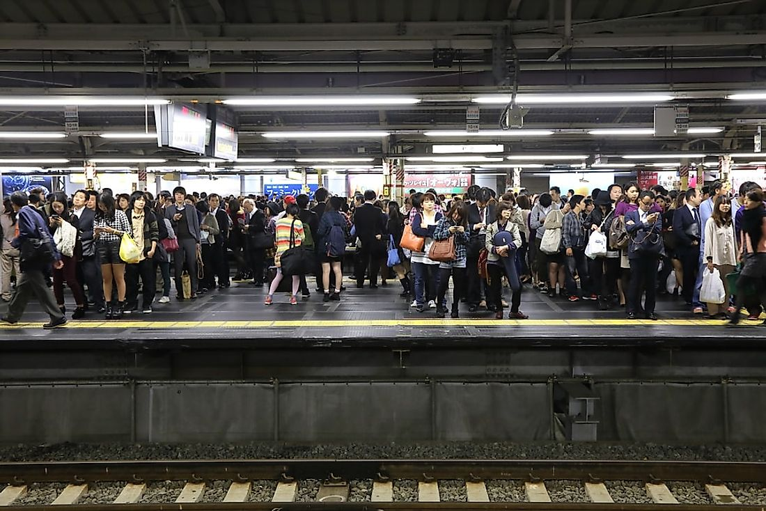 Passengers wait at Shinjuku Station, the busiest train station in the world. Editorial credit: charnsitr / Shutterstock.com.