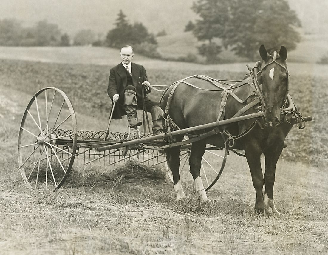 Coolidge retired to a quiet life as a boating enthusiast, hobby farmer, and sportsman after his Presidency. Above, he is raking hay at his childhood home in Vermont.