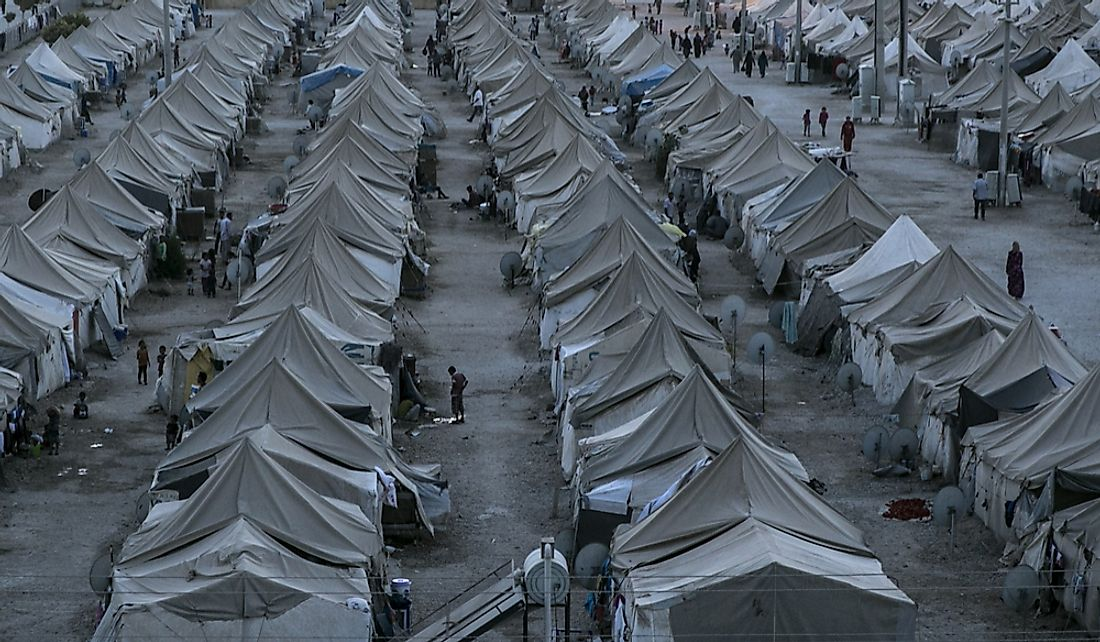 Thousands of Syrian refugees live at the Akcakale Tent Camp in Urfa, Turkey.  Editorial credit: Tolga Sezgin / Shutterstock.com