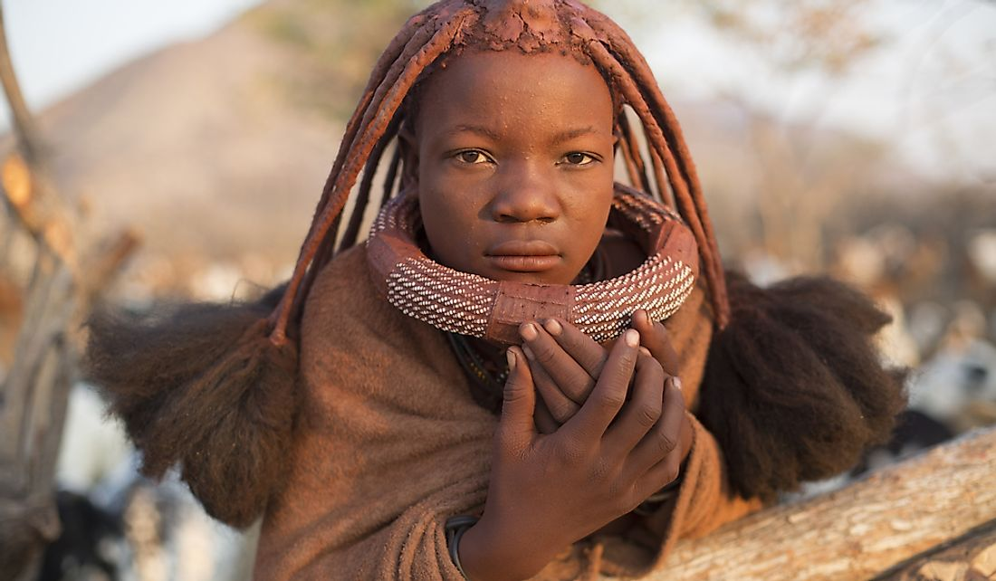 A young Himba girl in Epupa, Namibia.  Editorial credit: 2630ben / Shutterstock.com