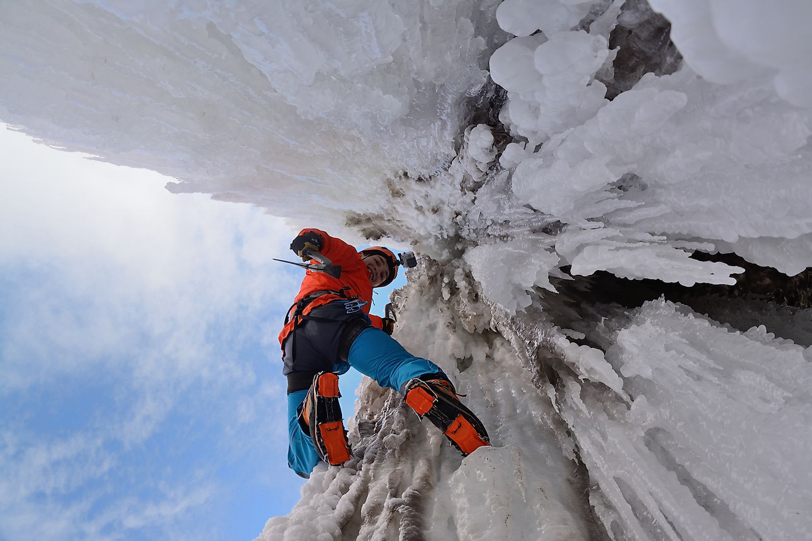An ice climber on a waterfall. Image credit: Artem Novichenko/Shutterstock.com