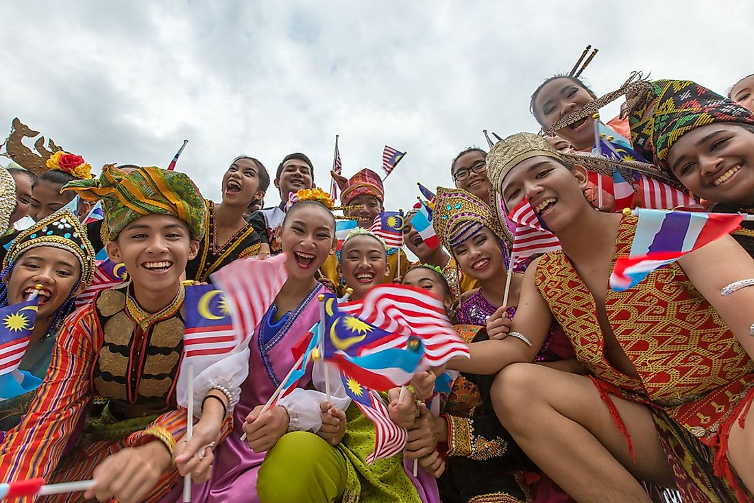 Malaysians celebration in the National Day Parade. Editorial credit: Yusnizam Yusof / Shutterstock.com.