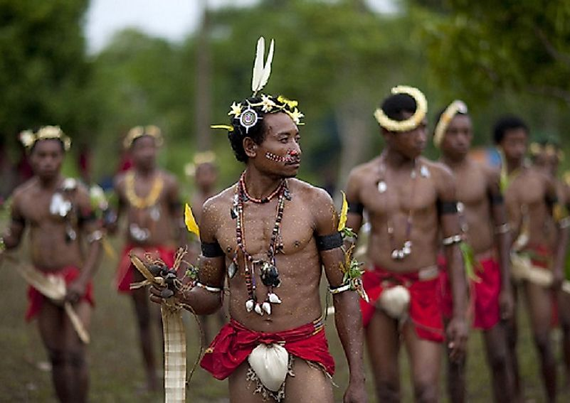 Male Trobrianders taking part in a traditional dancing ritual.