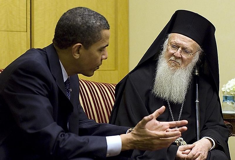 Bartholomew I, the current Archbishop and Patriarch of Constantinople, sitting and talking with U.S. President Barack Obama.