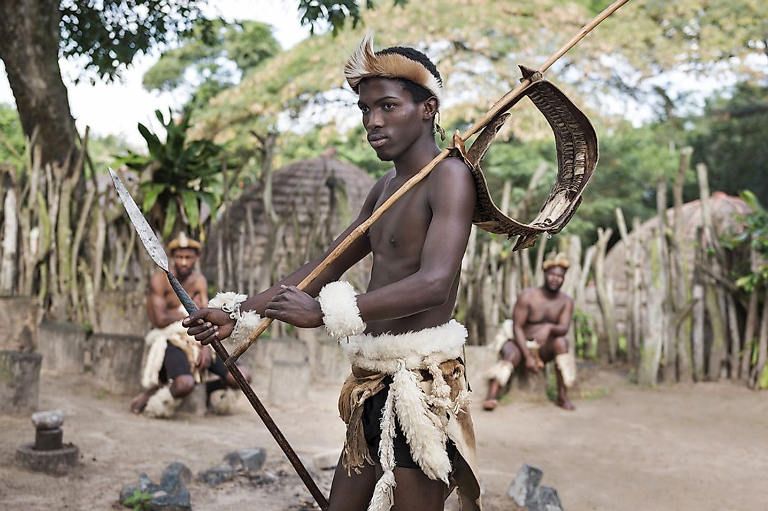 A Zulu warrior in traditional dress in Khula, a Zulu village in South Africa. Editorial credit: Jazzmany / Shutterstock.com