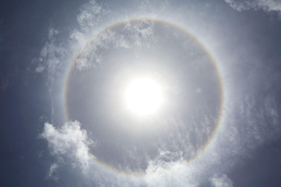 "This phenomenon seen in the sky is known as an ""ice crystal halo"". False sunrises can result from ice crystal halos."