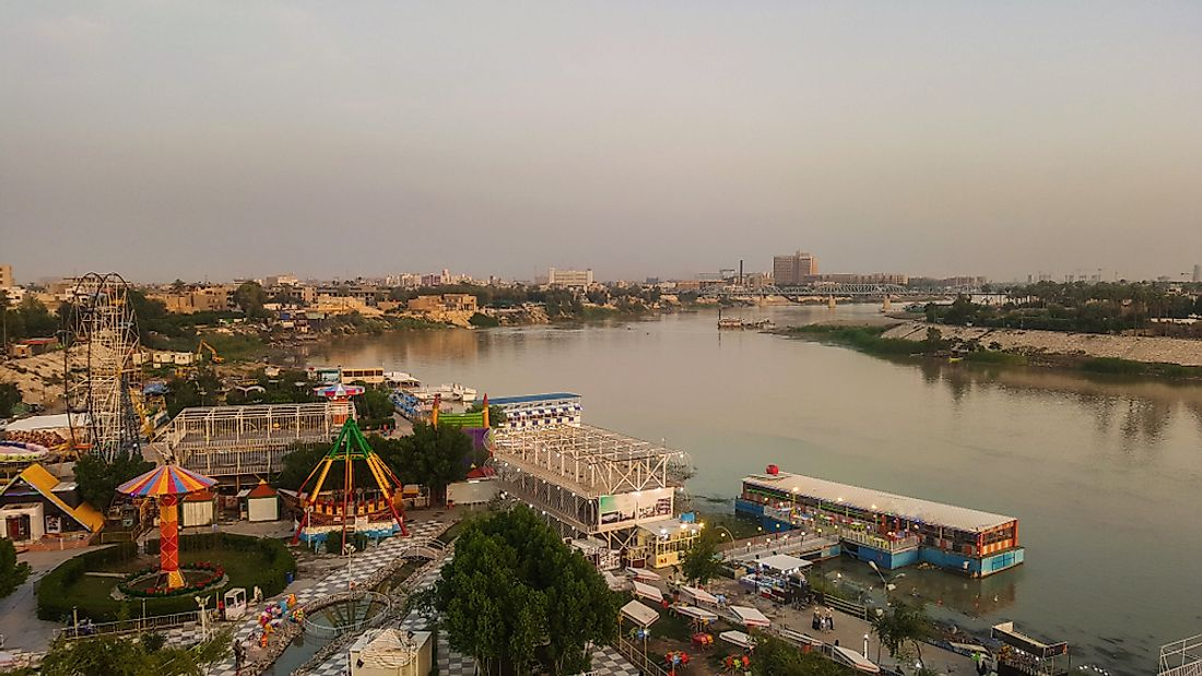 The city of Baghdad is located on a massive plain bisected by the Tigris River.