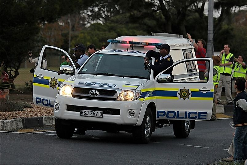 Police in Cape Town, South Africa block the road to deal with a public disturbance on the city's streets.