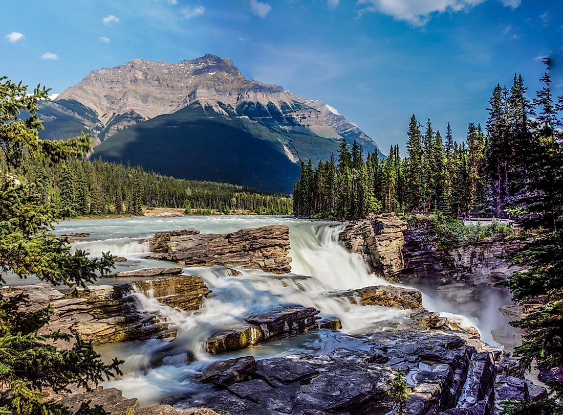 The rapid waters of Athabasca Falls, in Alberta's Jasper National Park, run through the meeting place of the Candian Prairie and the Rocky Mountains.