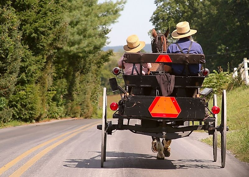 Old Order Amish, such as these in Lancaster, Pennsylvania, are associated with minimal utilization of modern technology, and thusly many travel by horse and buggy.