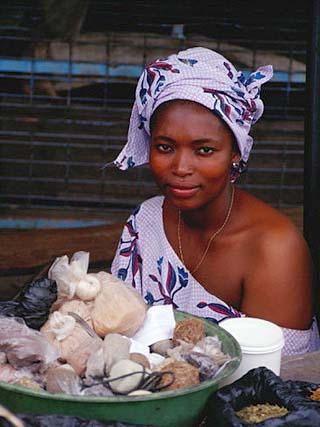 Female Spice Vendor at Market, Looking at Camera, Yamoussoukro, Cote d'Ivoire