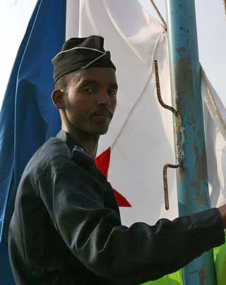 Djiboutian soldier and flag