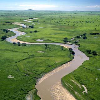 The Garamba River Winds Through the Grasslands of the Garamba National Park in Northern Congo