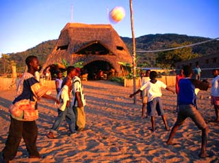 People Playing Volleyball Outside Indaba Bar, Cape Maclear, Malawi