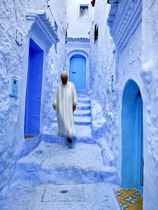 Man in Traditional Moroccan Clothes Walking Down Painted Blue and Steps, Chefchaouen, Morocco