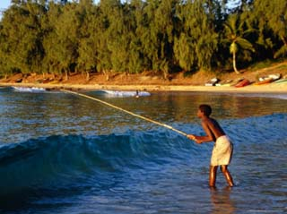 Boy Fishing off Beach, Tofo, Mozambique