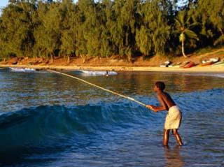 Boy Fishing off Beach, Tofo, Mozambique