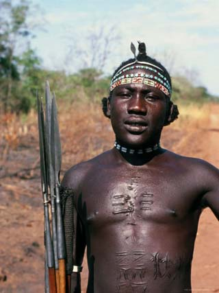 Portrait of a Man with Spears and Elaborate Scarring, Azende, Sudan, Africa