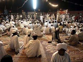 Celebrating the Prophet's Birthday, a Sheikh Preaches to Members of His Tariqa, Shendi, Sudan