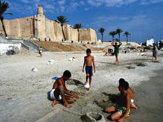 Children Playing on Beach in Front of Restored Fort Ribat, Monastir, Tunisia