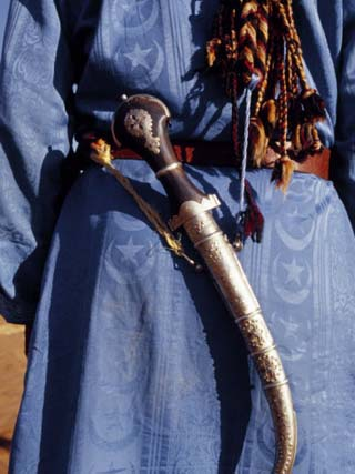 Berber Tribesman Wears a Knife on Sash over Shoulder and Blue Robe, Sahara Region of Morocco