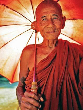Smiling Monk Holding Umbrella, Mrauk U, Myanmar (Burma)