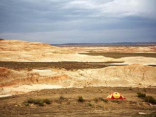 Tent Near the Wucaiwan Formation in the Gobi Desert