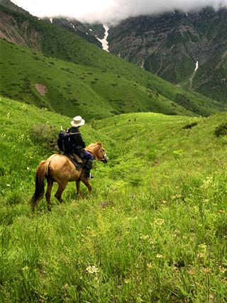 Tourist on Horseback in the Aksu Dzhabagly Reserve, Tien Shan Mountains in Kazakhstan, Central Asia