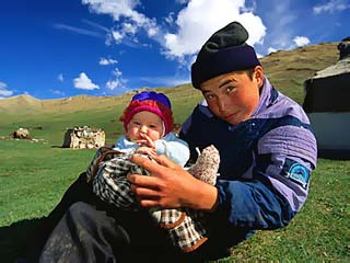 Boy and Baby in Front of Yurt Camp, Kyrgyzstan
