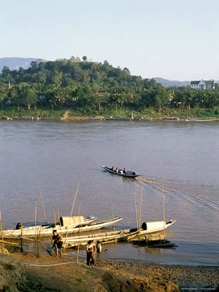 Looking East Across Mekong River to Phousi Hill and Temple in the Evening, Laos, Southeast Asia