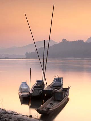 Boats on Mekong River at Sunset, Luang Prabang, Laos