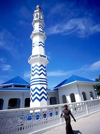 Woman Walking Past Minaret Eydhafushi, South Maalhosmadulu Atoll, Baa, Maldives
