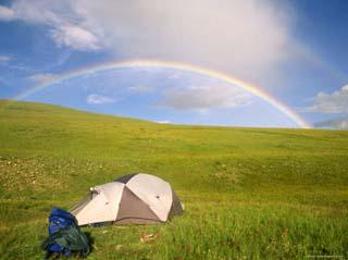 Rainbow Arcs over a Campsite on a Mongolian Steppe