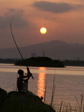 Pakistan Boy Fishing at Rawal Lake in the Suburb of Pakistani Capital Islamabad
