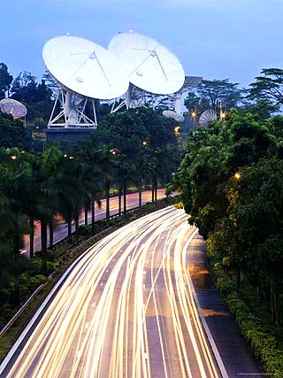 Traffic Rushes Past the Bukit Timah Satellite Earth Station at Night
