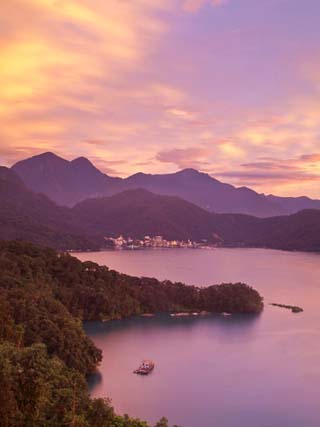Taiwan, Nantou, View of Sun Moon Lake at Sunset