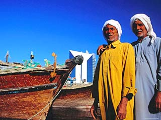Two Arab Workers in Dhow Harbour, Dubai, United Arab Emirates