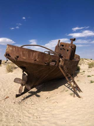 Rusting Boats Lying in the Desert Which Used to Be the Aral Sea, Moynaq, Uzbekistan, Central Asia,
