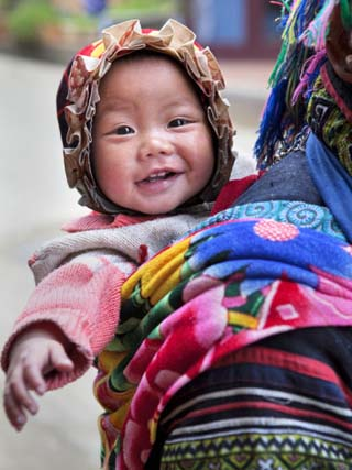 Portrait of Black Hmong Baby in Sling Attached to Mother, Sapa, Lao Cai, Vietnam, Indochina