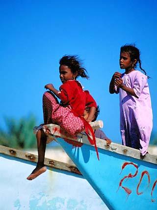 Young Girls on Dhow Fishing Boat Near Qalansia Village, Yemen