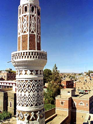 The Minaret of a 15th Century Mosque Rises Above a San'a, Yemen Neighborhood