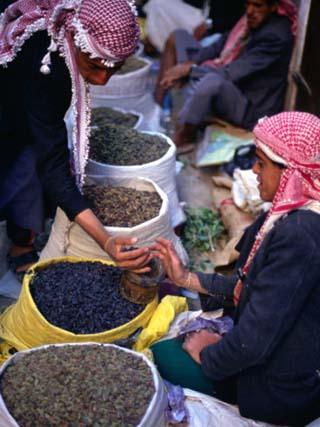Vendor and Customer at Suq (Market) Stall, San'a, Yemen