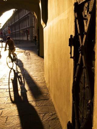 Early Morning Cyclist in Innsbruck's Altstadt (Old Town), Innsbruck, Austria
