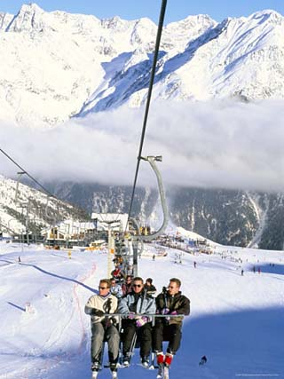 Skiers Riding Chairlift up to Slopes from Village of Solden, Tirol Alps, Tirol, Austria