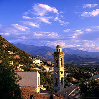 Evening View Across Rooftops and Church Tower to Mountains, Lumio, Near Calvi, Corsica, France