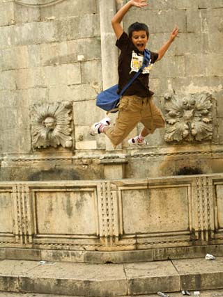Boy jumping from the Big Fountain of Onofrio, Dubrovnik, Dalmatia, Croatia