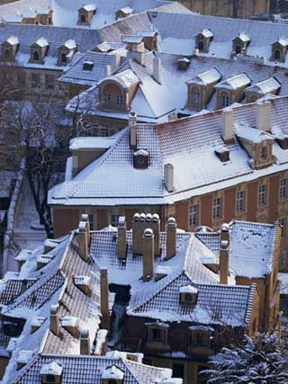 Aerial View of Snow Covering Roofs in Winter in the Lesser Town of Prague, Czech Republic, Europe