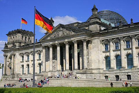 The German flag flying outside the Reichstag, the home of German Goverment
