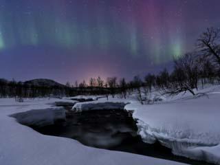 Aurora Borealis over Blafjellelva River in Troms County, Norway